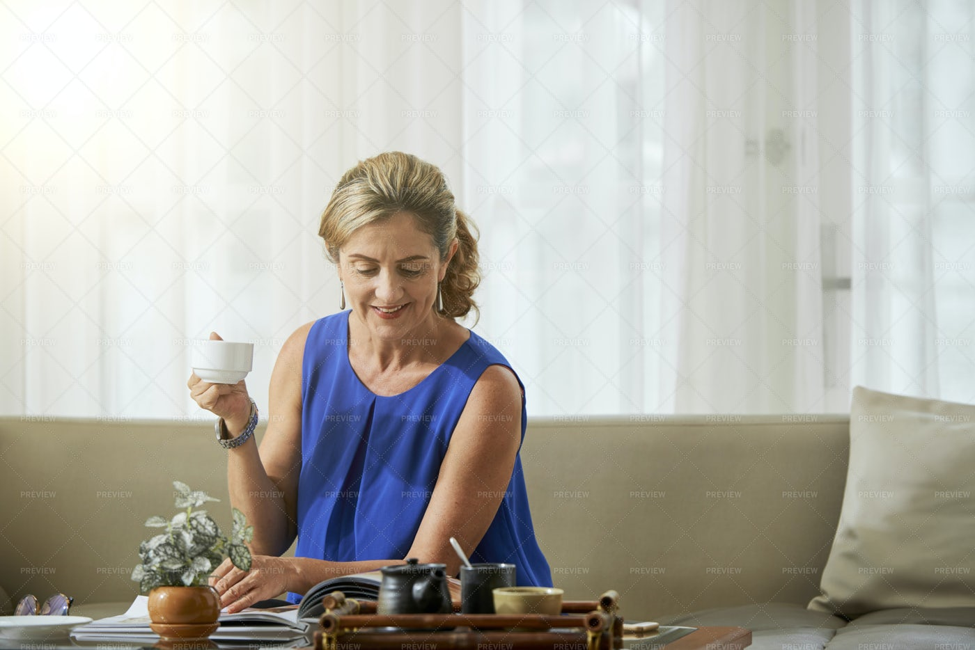 Woman Reading A Magazine: Stock Photos