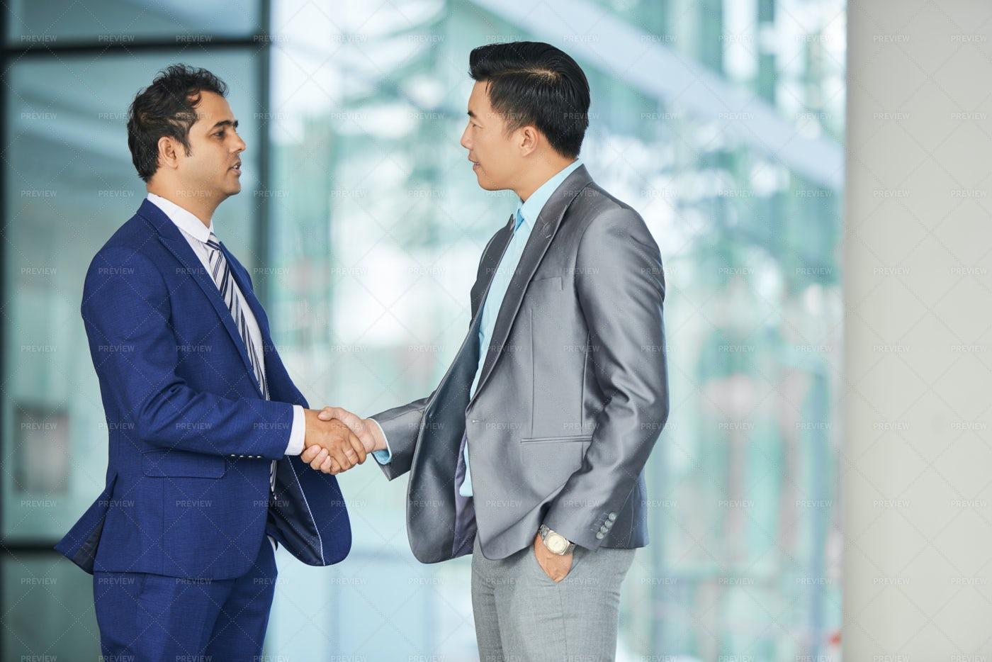 Businessmen Shaking Hands: Stock Photos