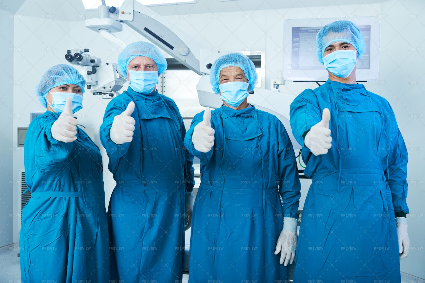 Cheerful Surgeons Showing Thumbs-up: Stock Photos