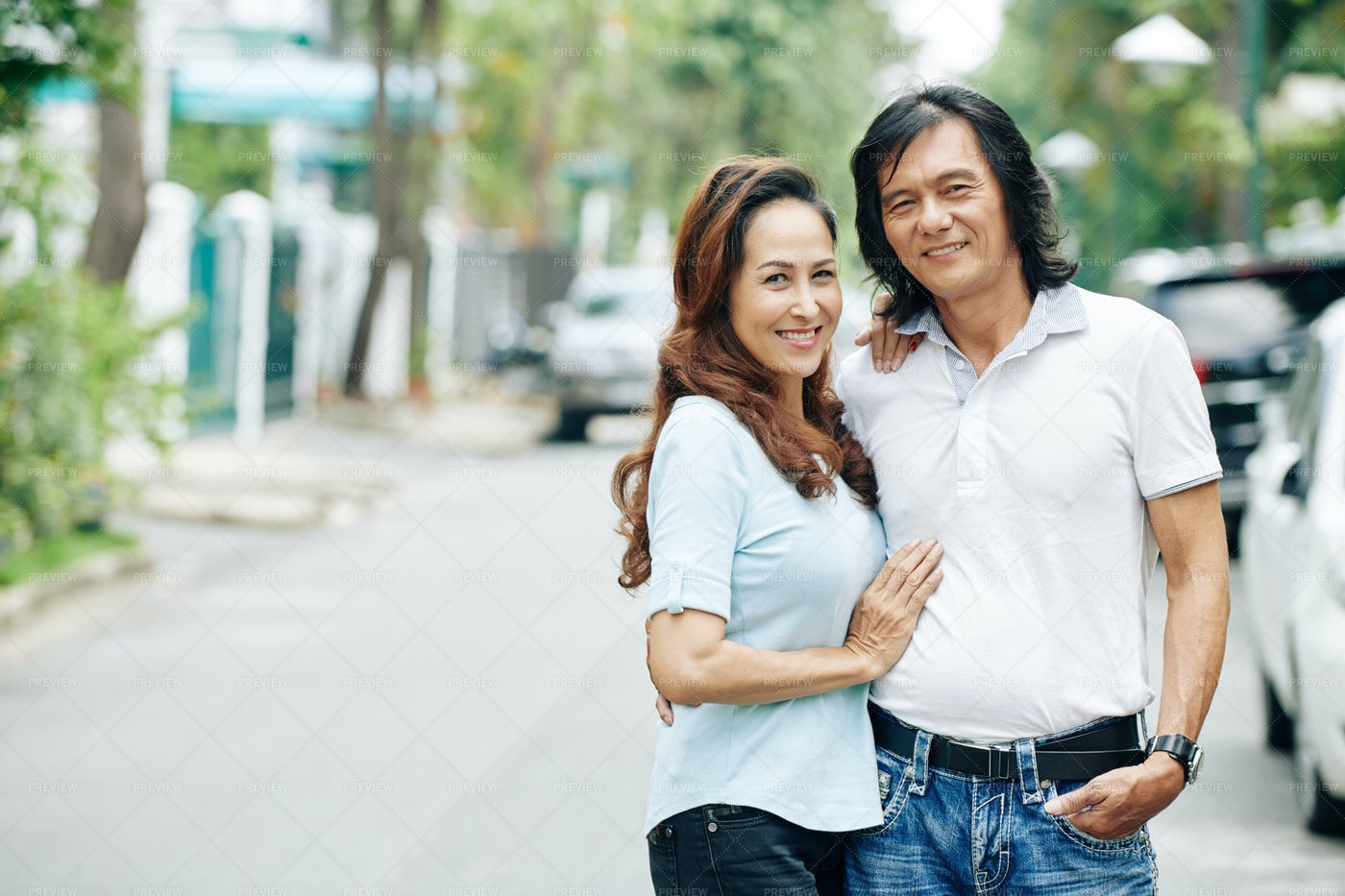 Smiling Middle-aged Vietnamese Couple: Stock Photos