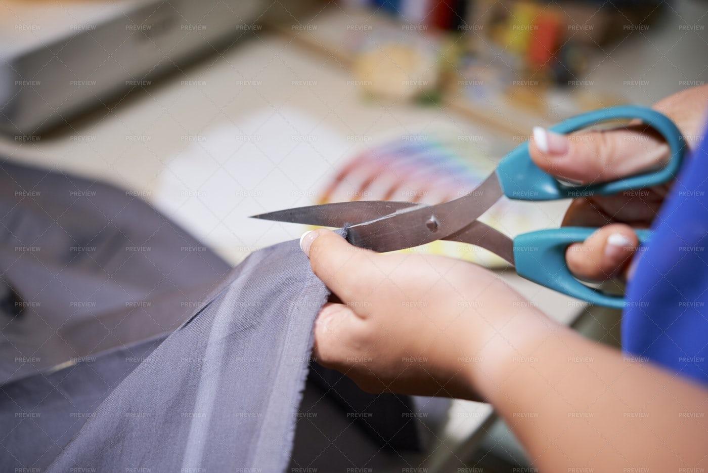 Tailor Cutting Fabric For Dress: Stock Photos