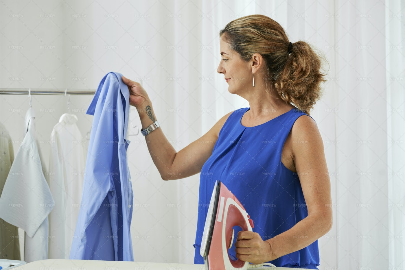 Housewife Ironing Clothes: Stock Photos