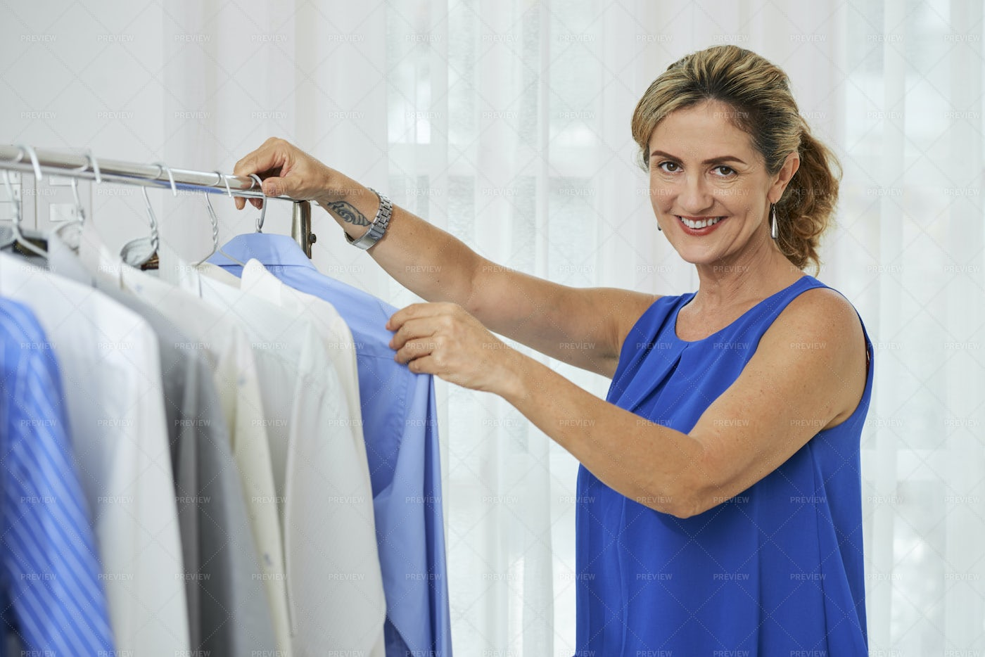 Woman Working In Laundry: Stock Photos