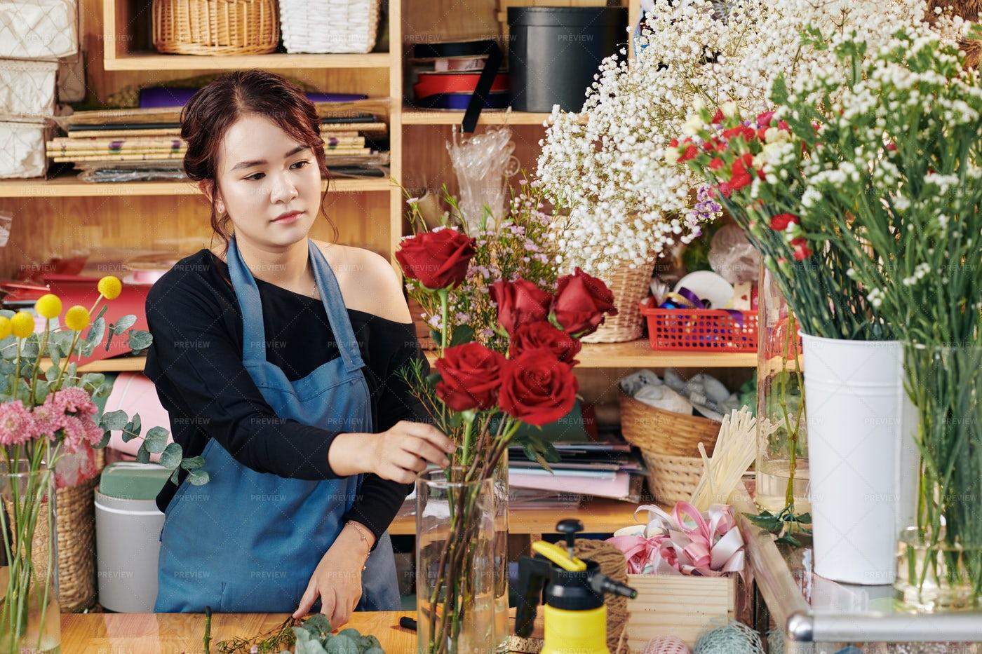 Florist Putting Flowers On Vase: Stock Photos