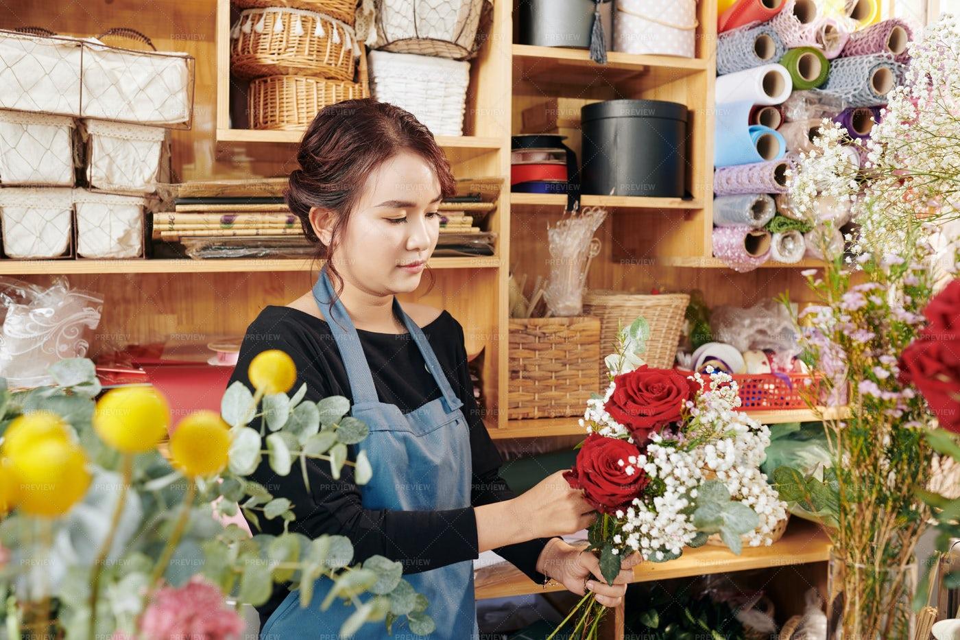 Florist Making Bouquet For Customer: Stock Photos
