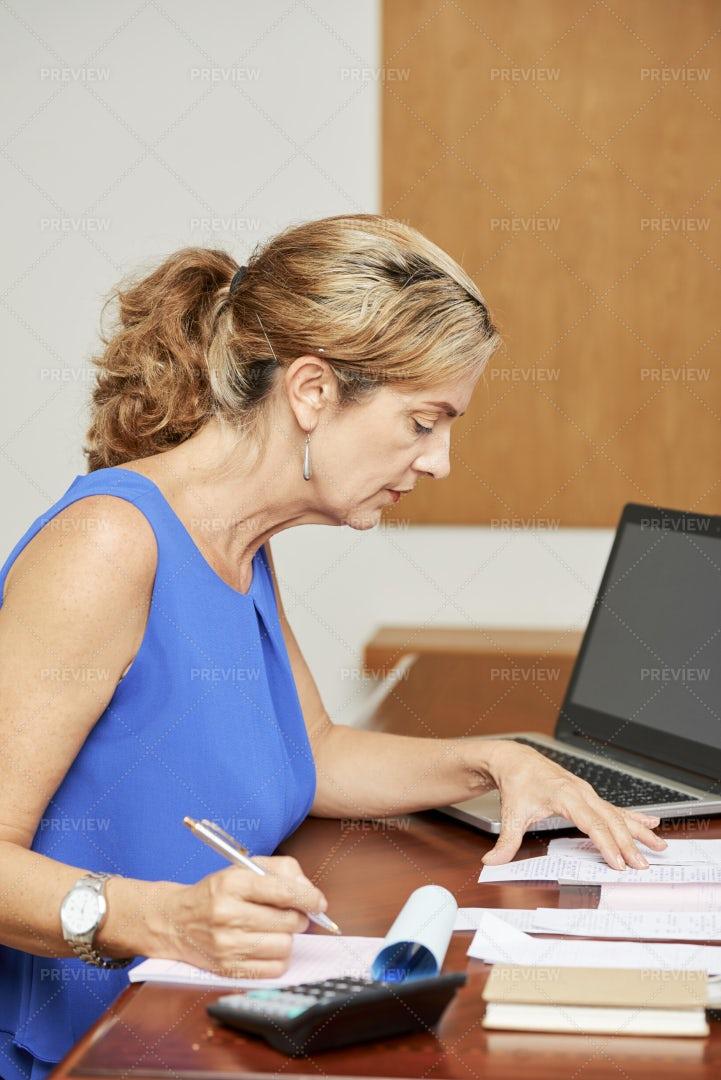 Woman Checking All Bills: Stock Photos