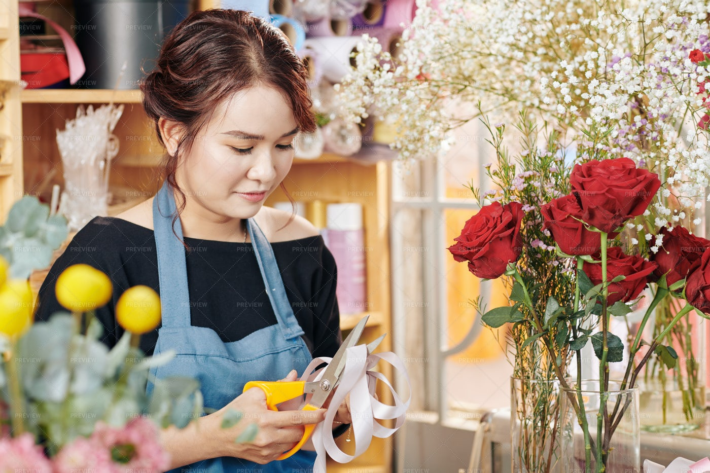Young Florist Cutting Ribbon For: Stock Photos