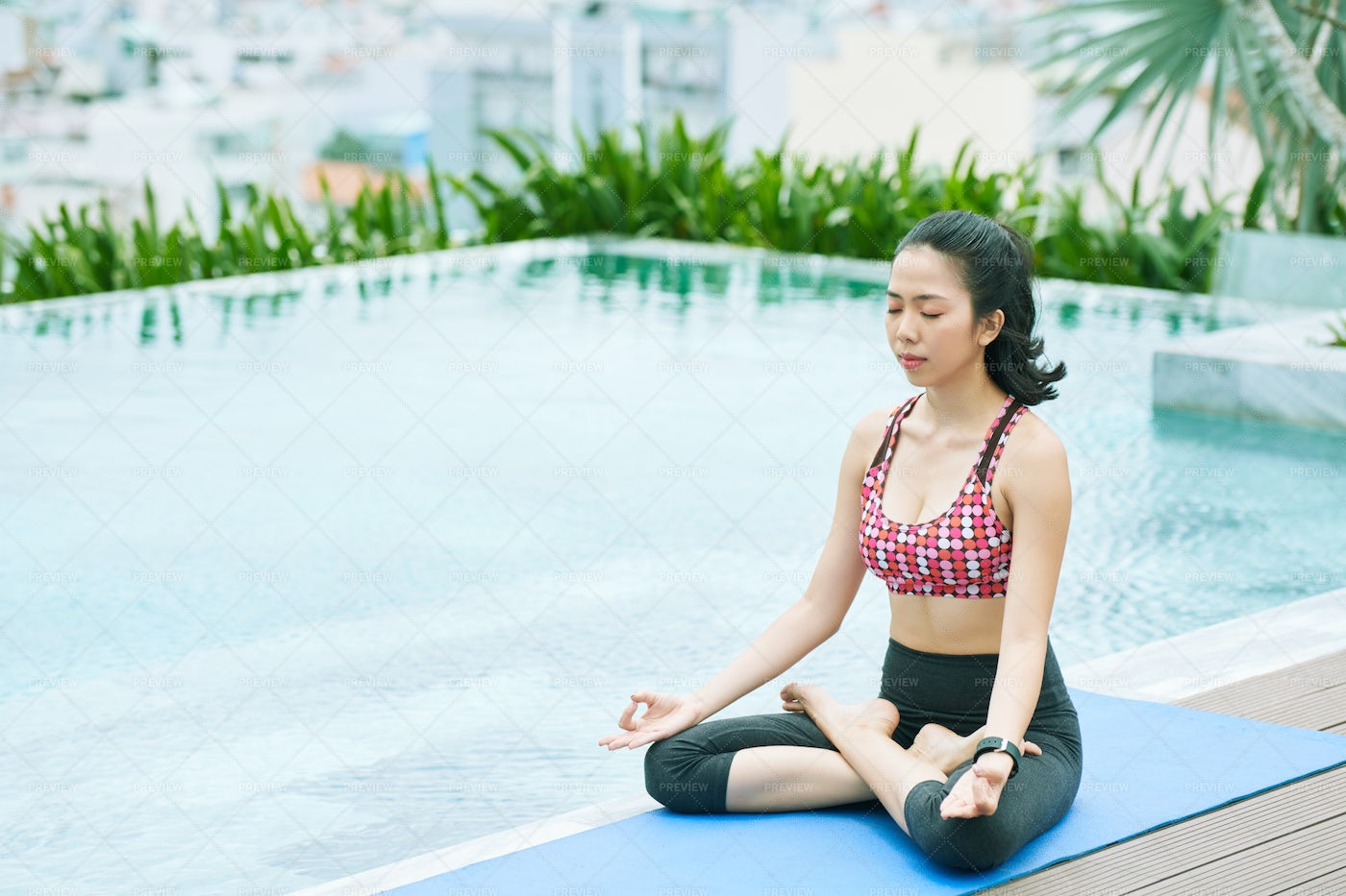 Woman Sitting In Lotus Position: Stock Photos