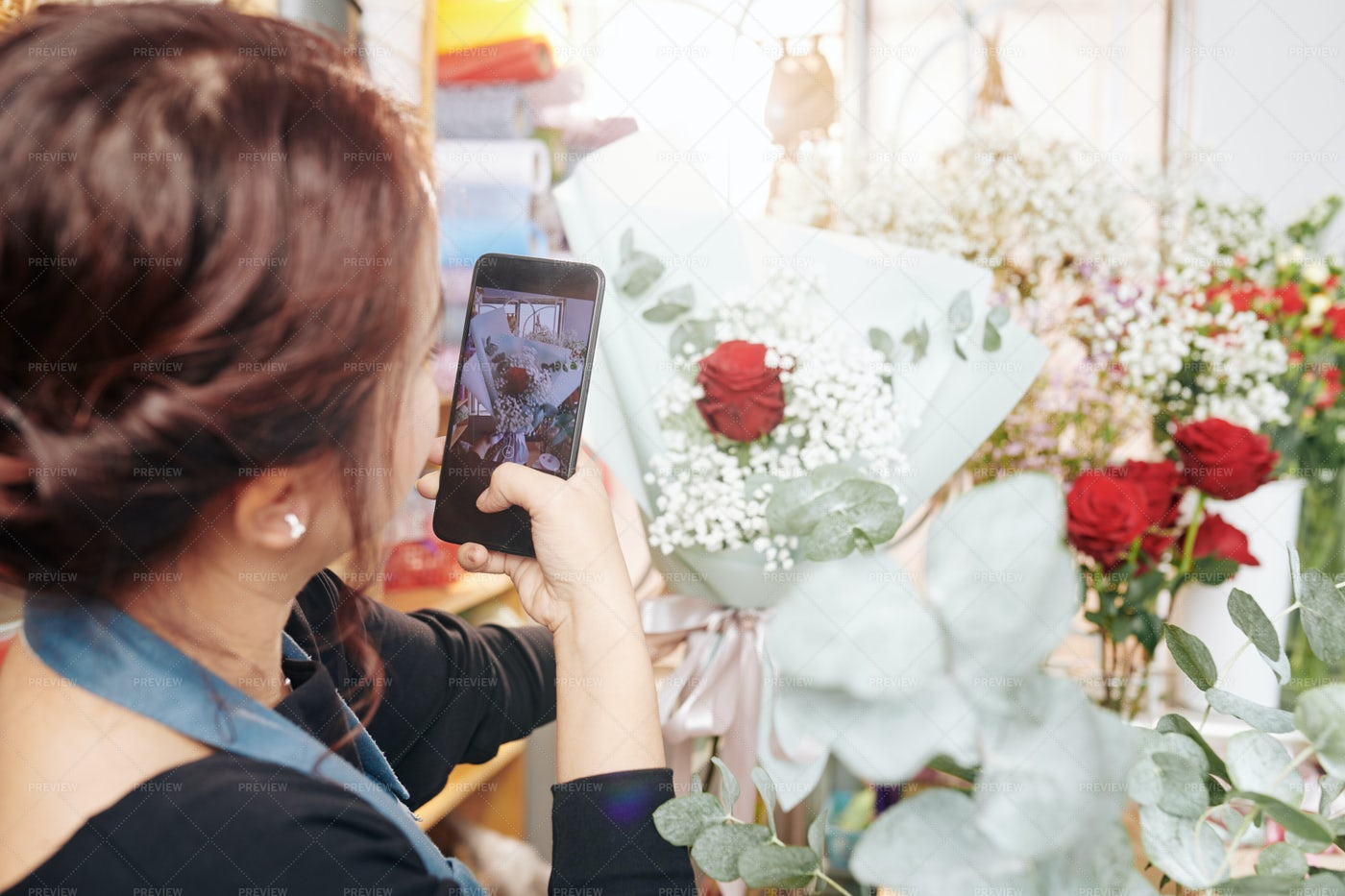 Florist Taking Phone Of Bouquet: Stock Photos