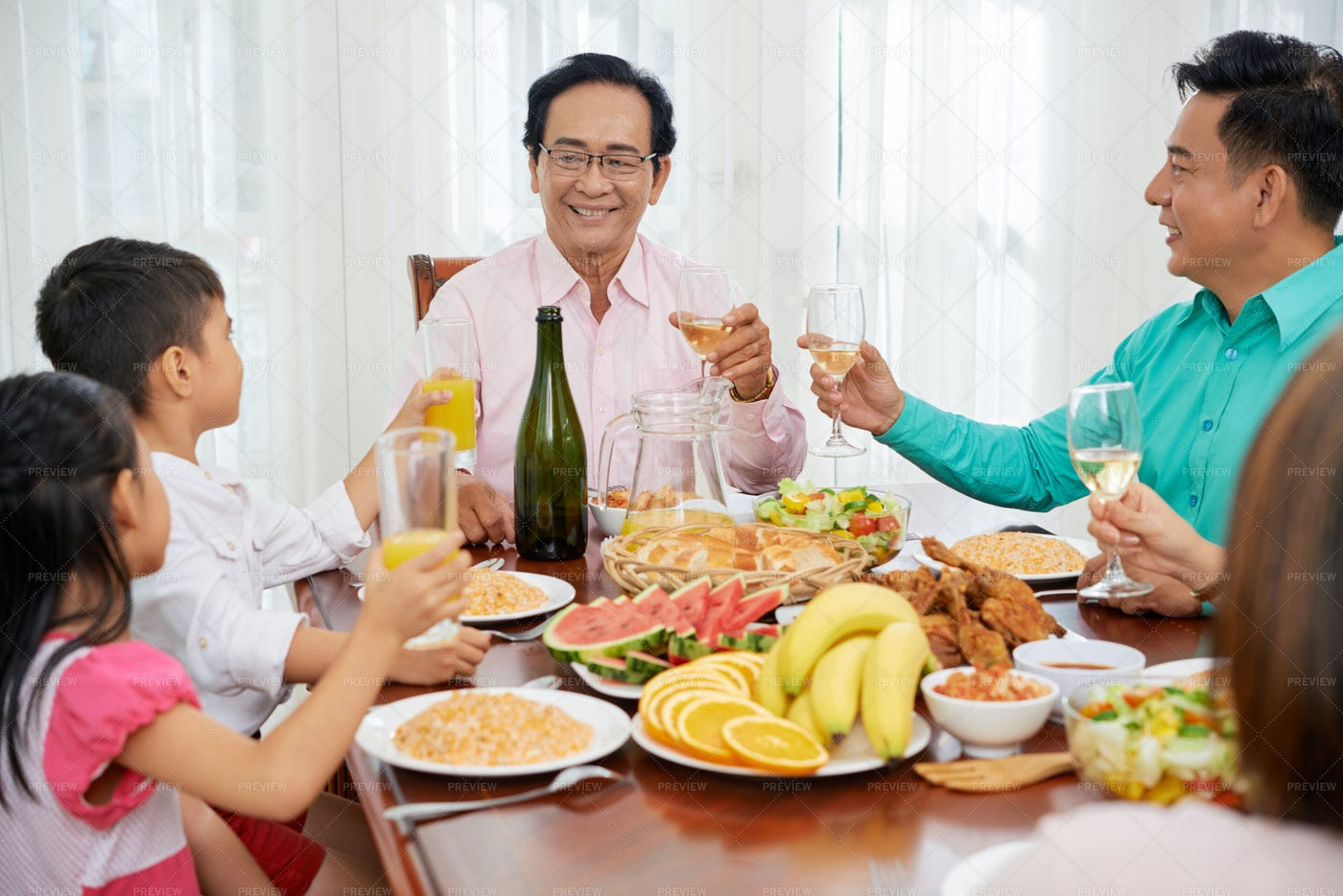 Cheerful Family With Children Toasting: Stock Photos