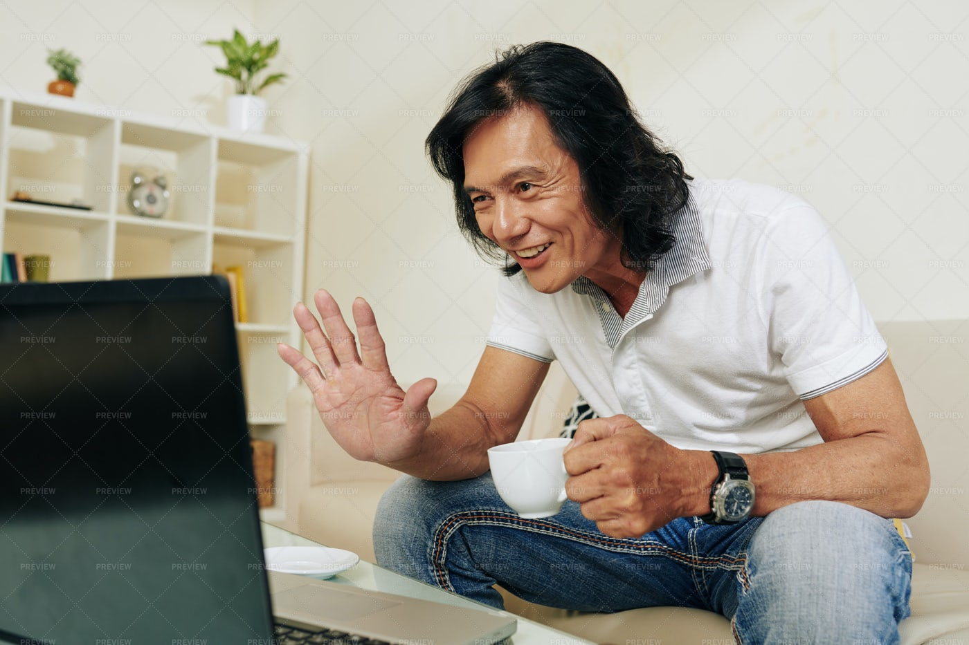 Man Video Calling Friend: Stock Photos