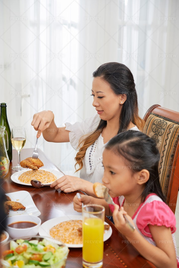 Woman On Family Dinner Filling Plate: Stock Photos