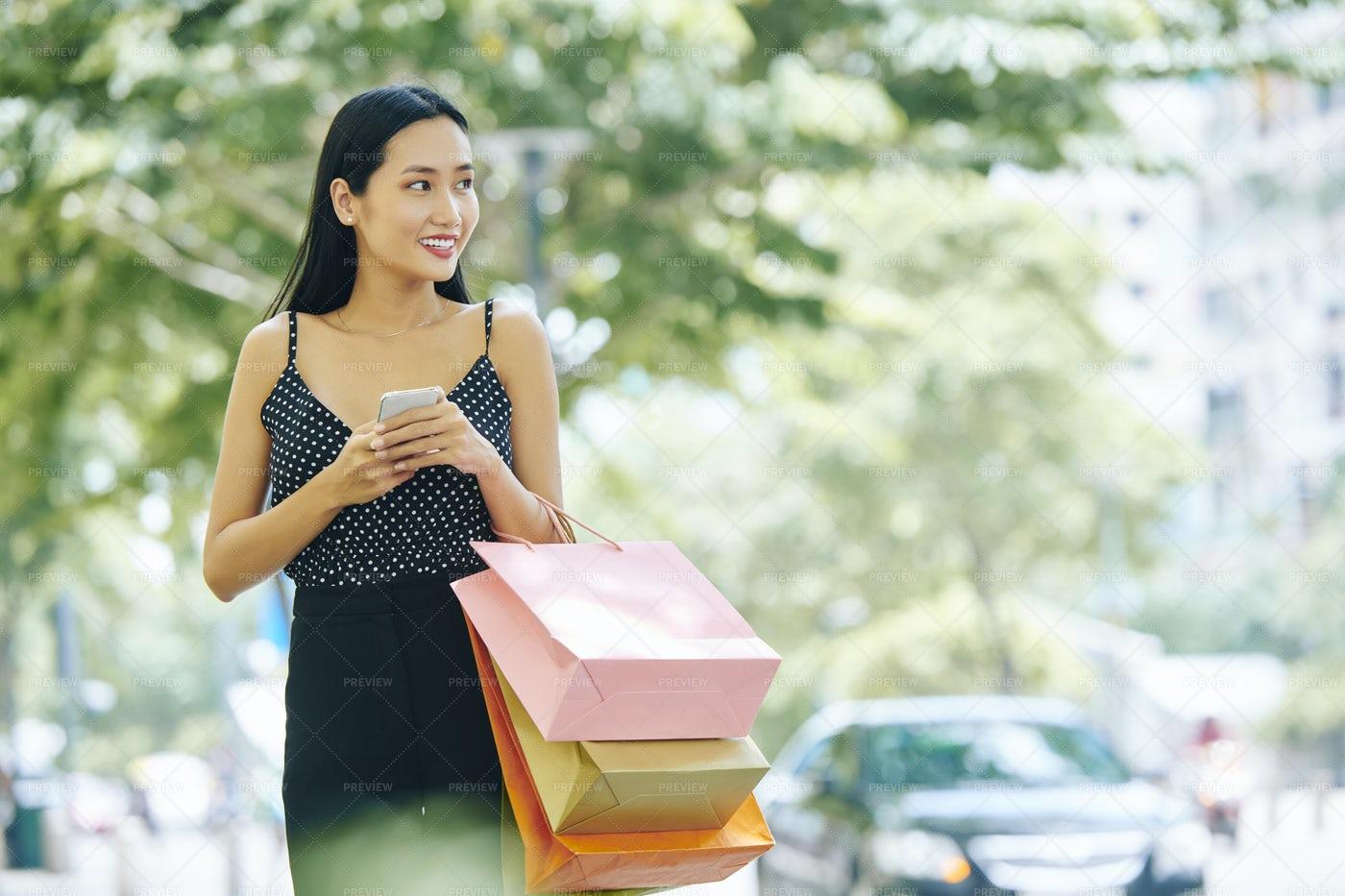 Asian Shopaholic In Big City: Stock Photos