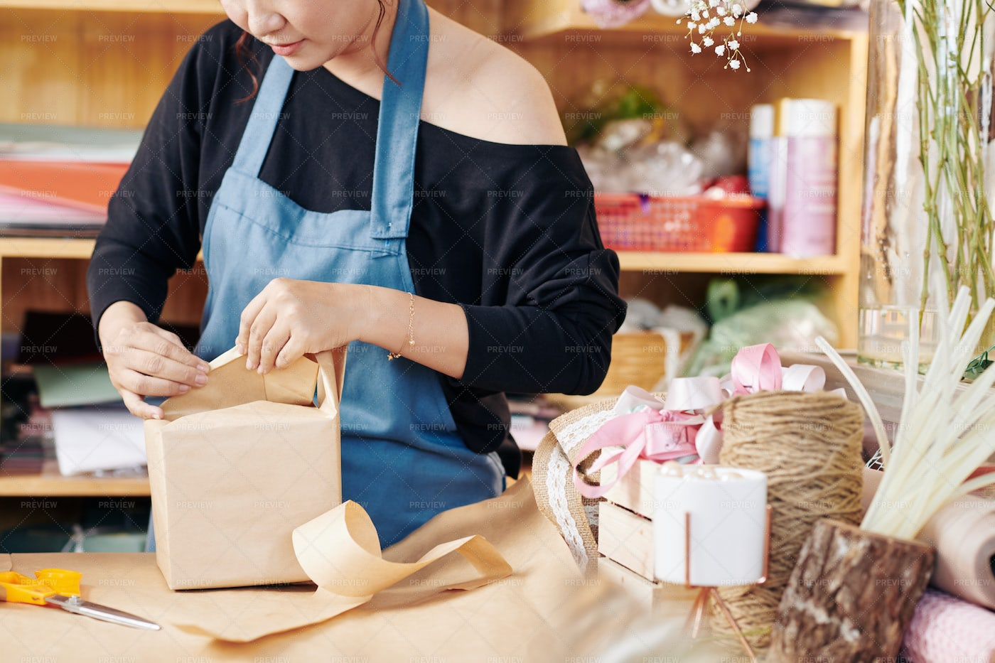 Woman Wrapping Gift: Stock Photos