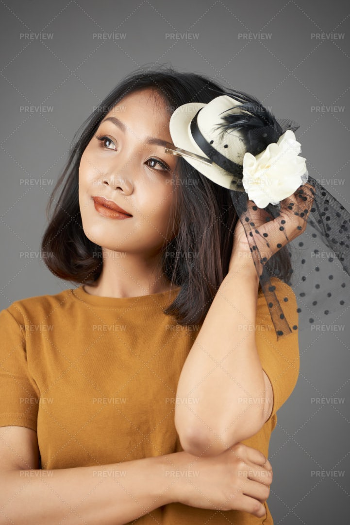 Elegant Woman Wearing Small Hat: Stock Photos