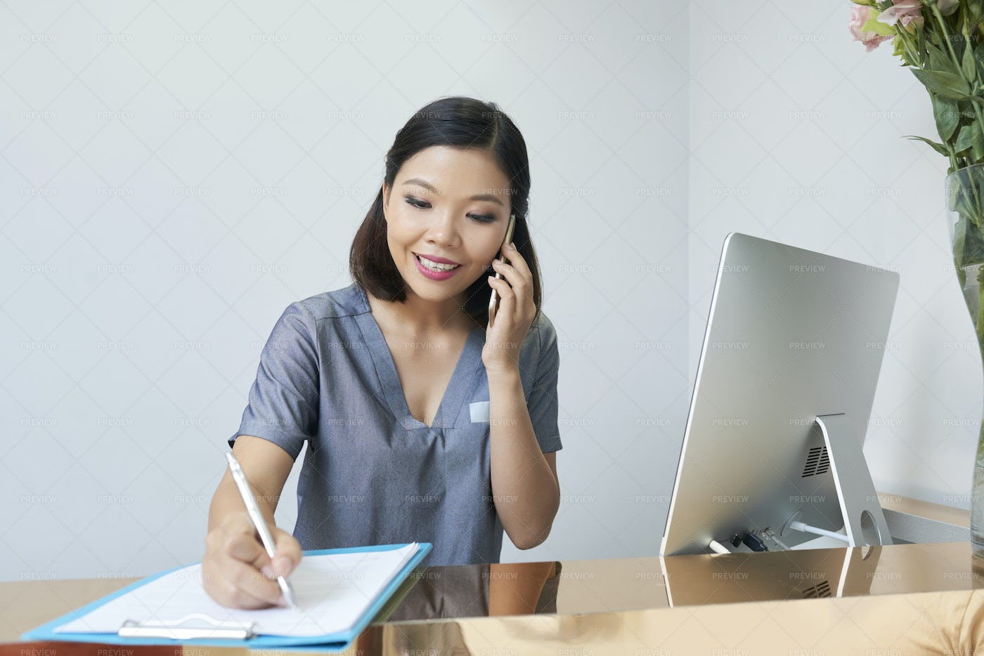 Receptionist At Work: Stock Photos