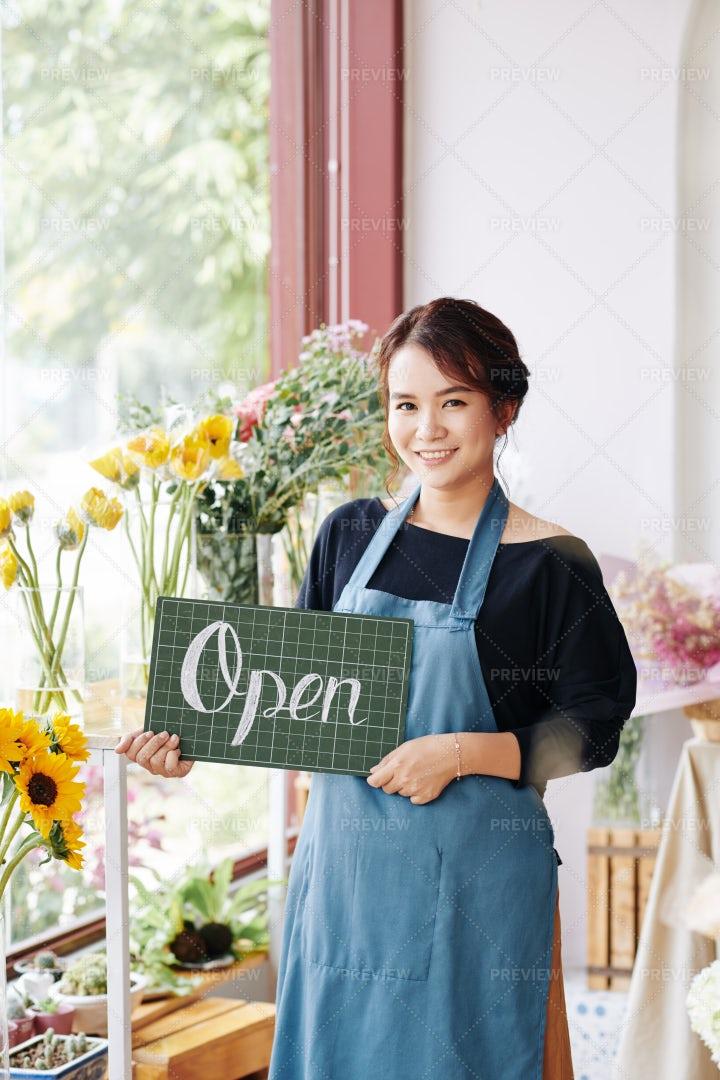 Lovely Florist Holding Open Sign: Stock Photos