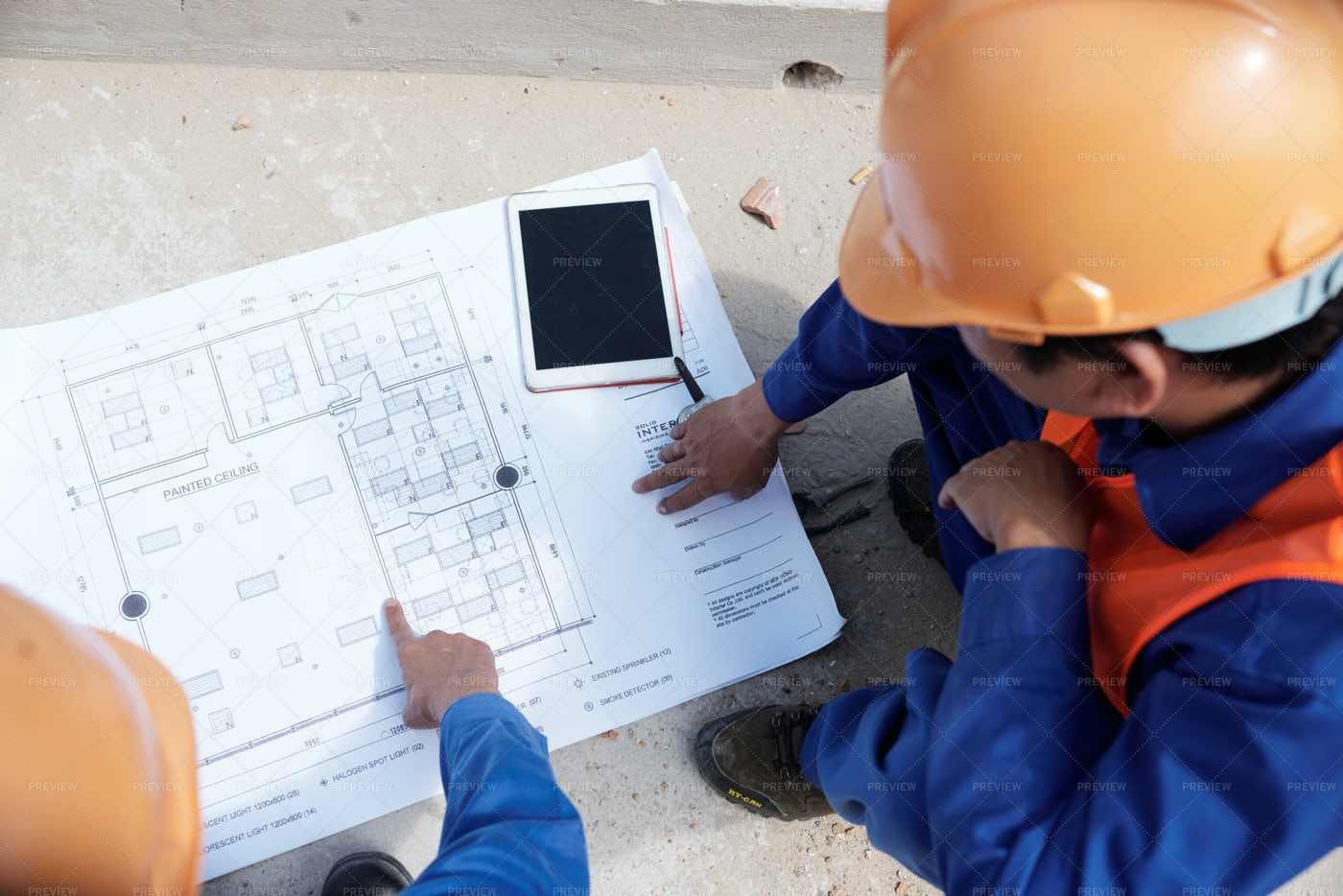 Working Discussing Building Of House: Stock Photos