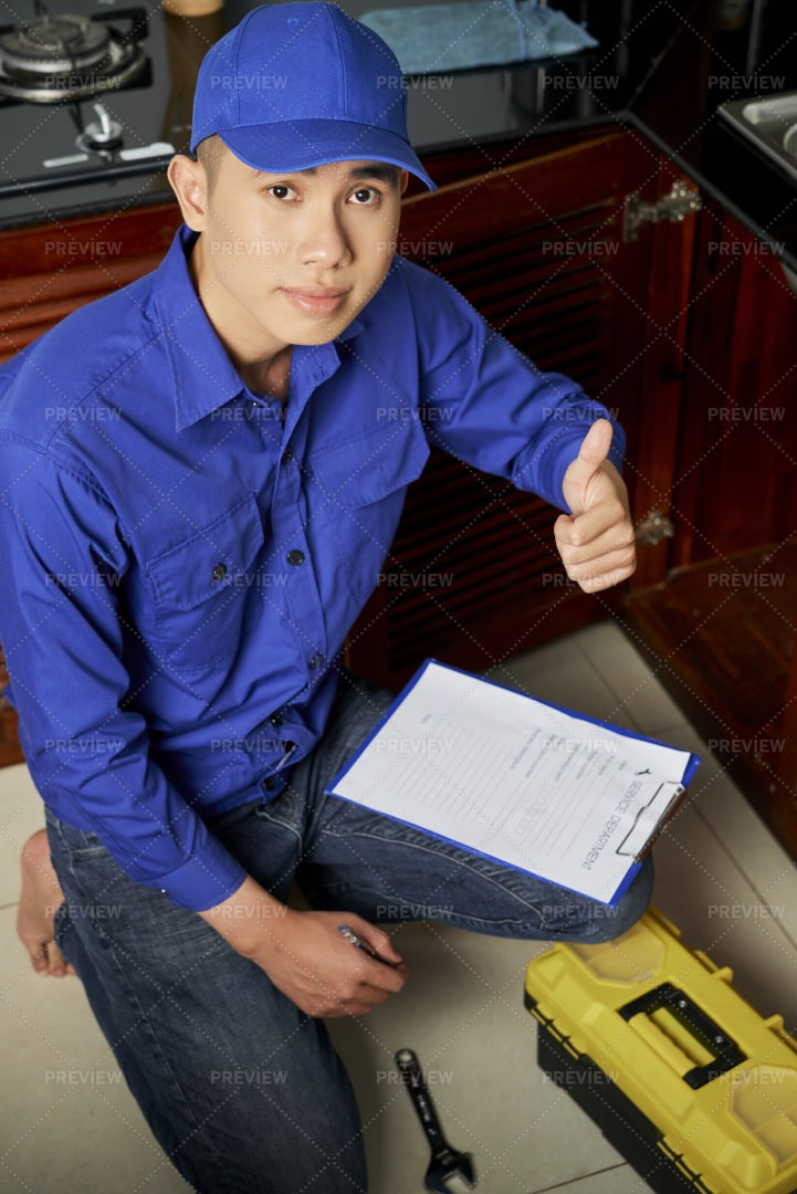 Repairman Does His Work Well: Stock Photos