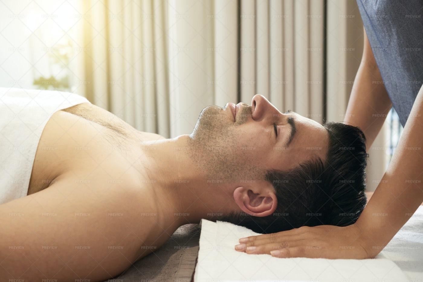Man Relaxing In Wellness Center: Stock Photos