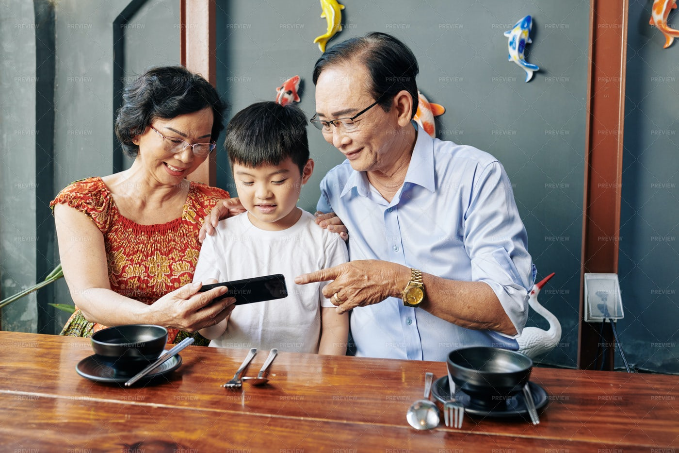 Senior People Showing Mobile App To: Stock Photos