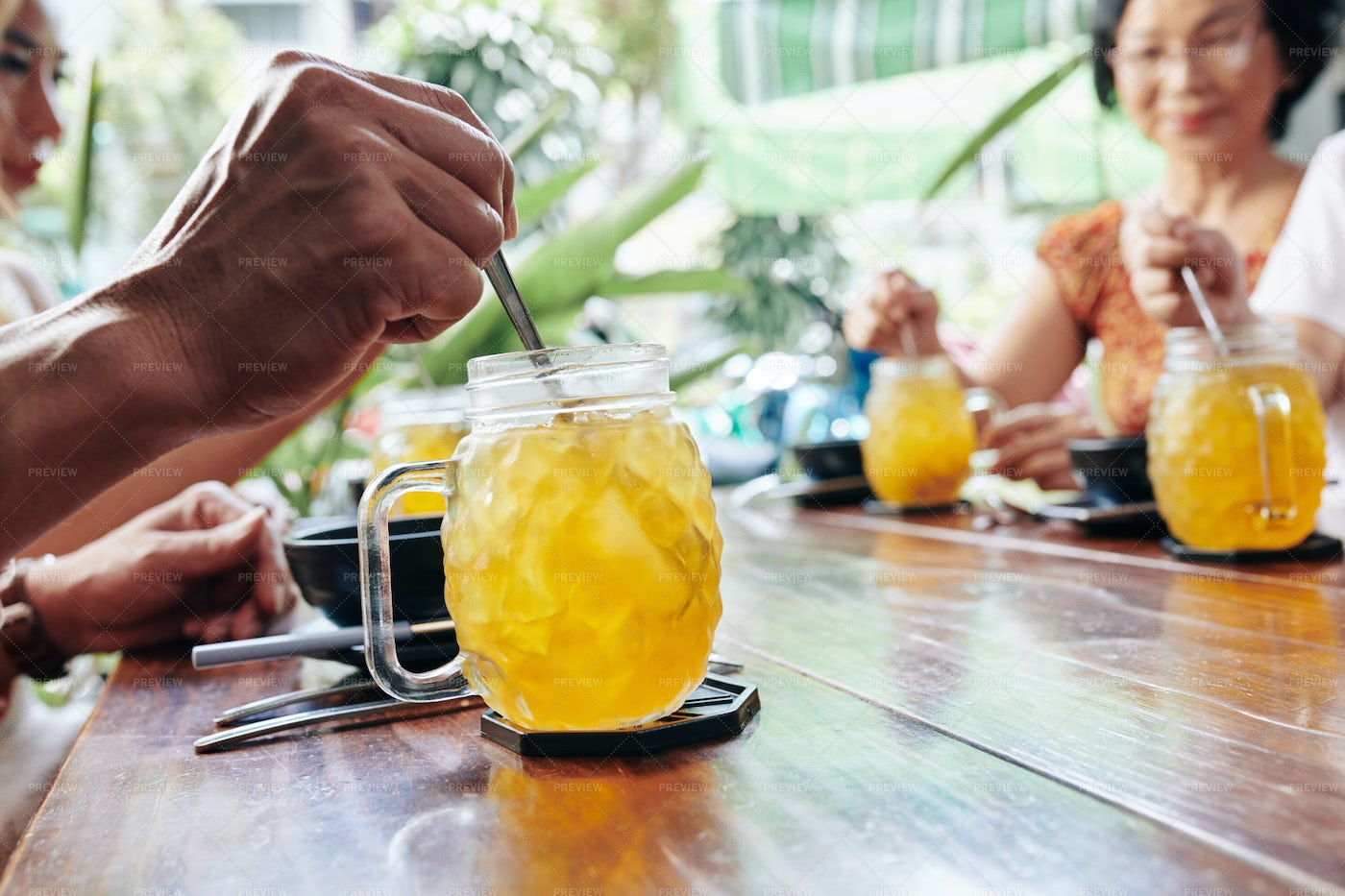 Cafe Visitor Mixing Pineapple Cocktail: Stock Photos
