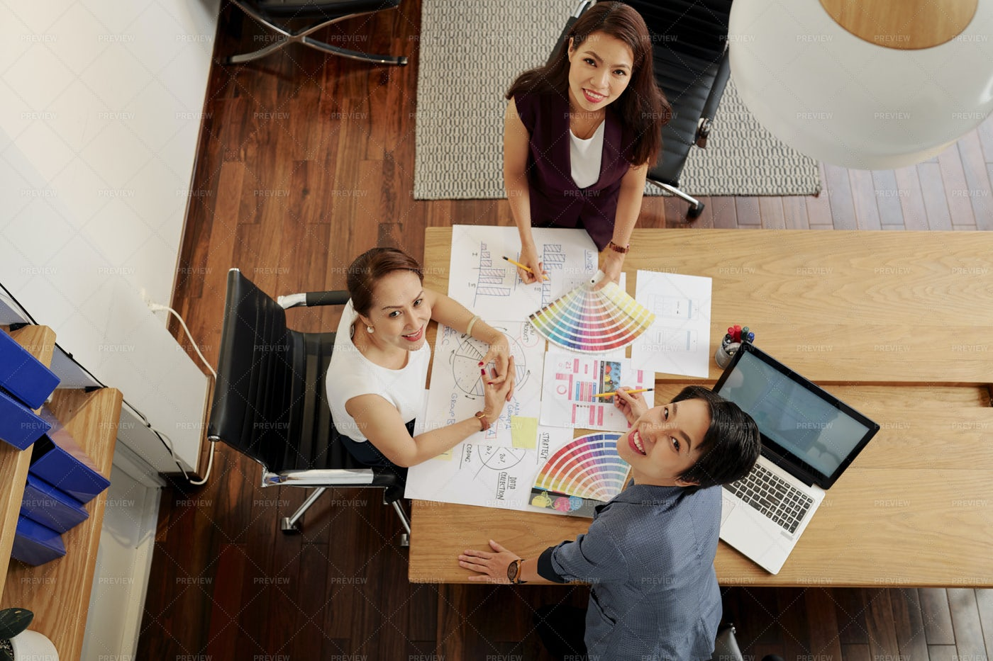Businesswomen Working Over New Design: Stock Photos