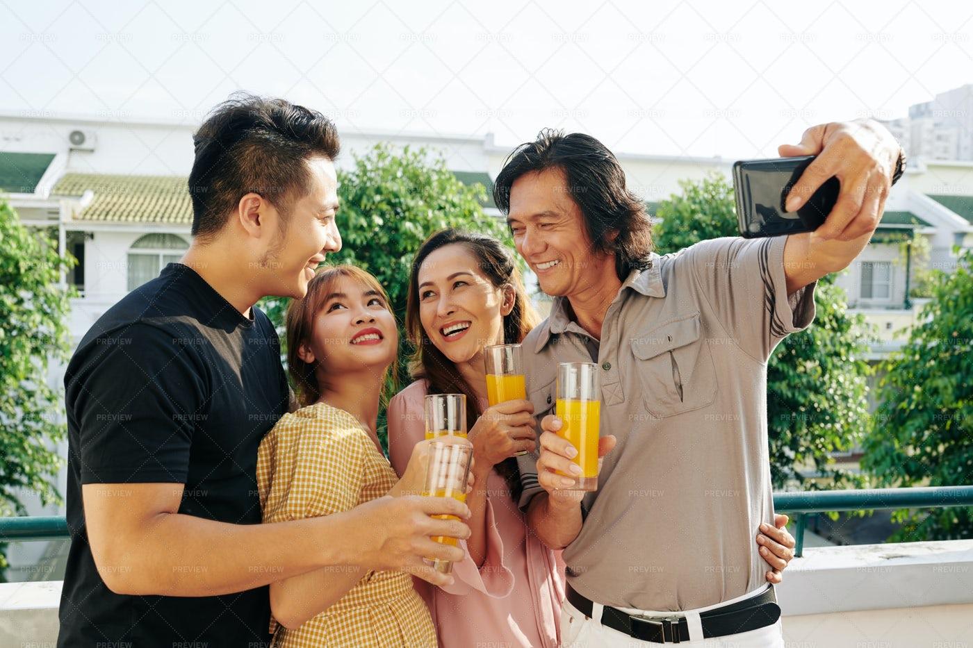 Happy Photographing Family: Stock Photos
