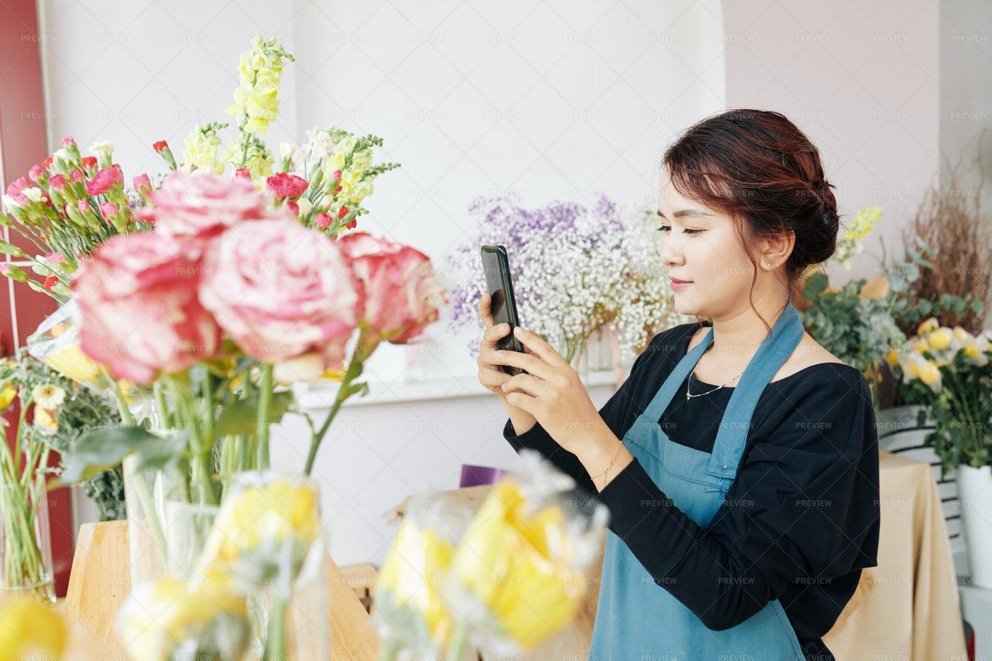Florist Posting Photos Of Bouquets: Stock Photos