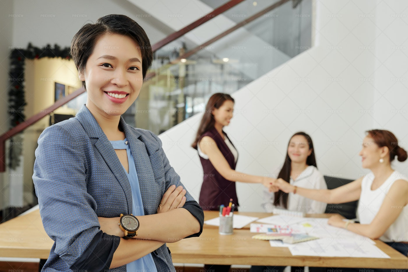 Businesswoman Working With Colleagues: Stock Photos