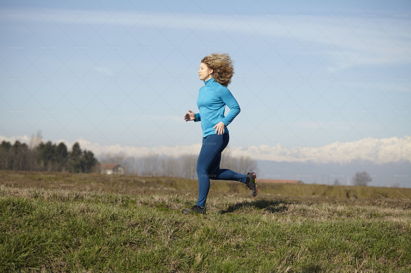 Woman Running In The Nature: Stock Photos
