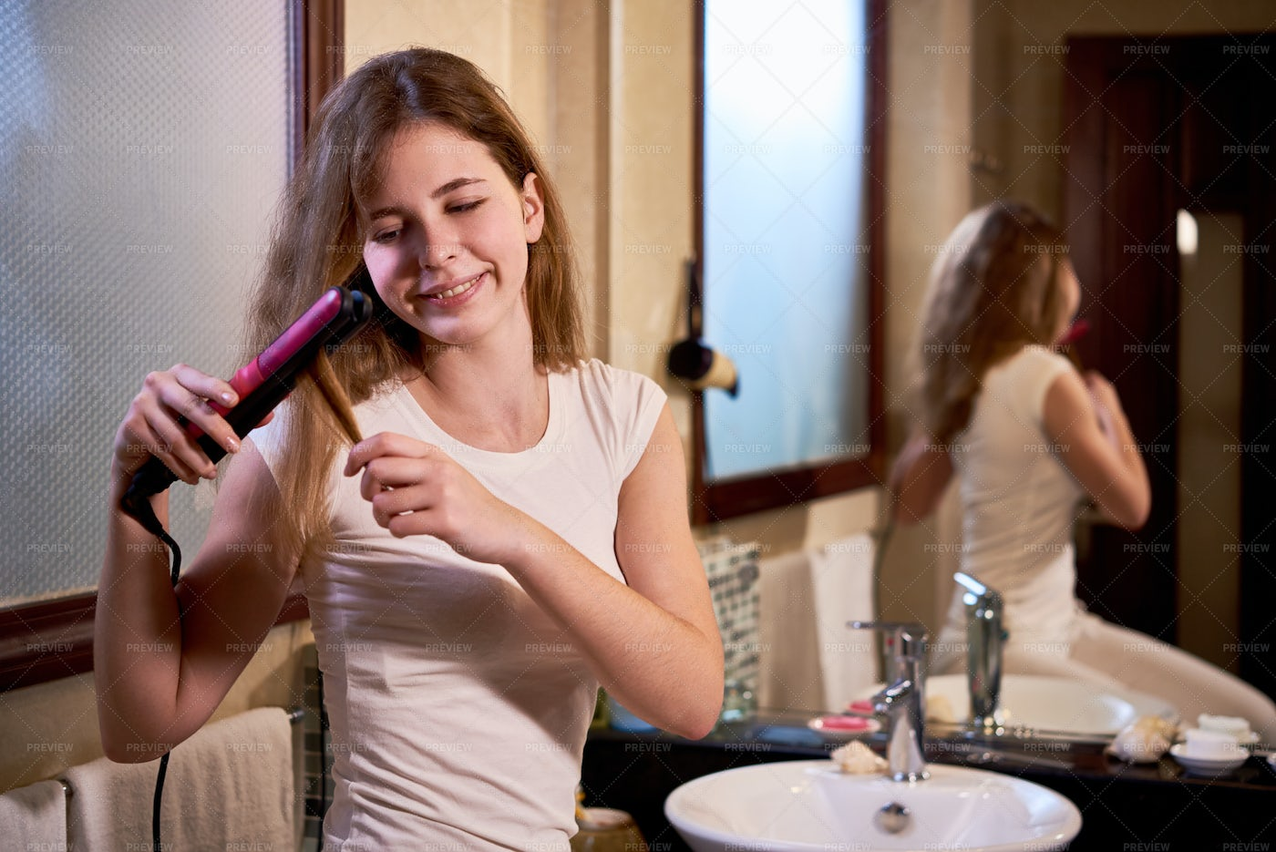 Woman Making A Hairstyle At Home: Stock Photos