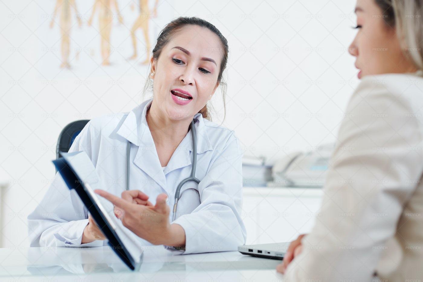 Cardiologist Explaining Cardiogram To: Stock Photos