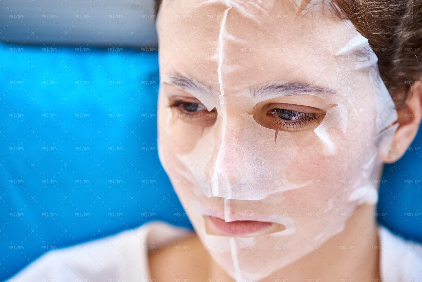 Woman In A Paper Facial Mask: Stock Photos