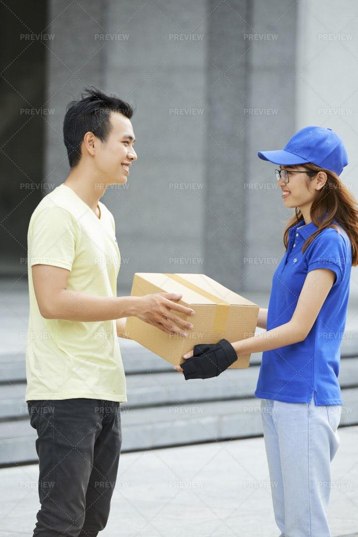 Courier Giving Cardboard Box: Stock Photos