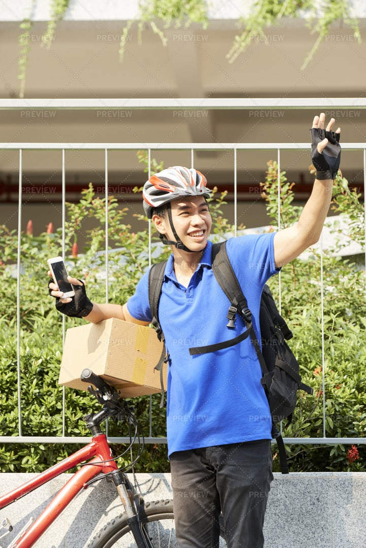Cheerful Courier With Bicycle: Stock Photos
