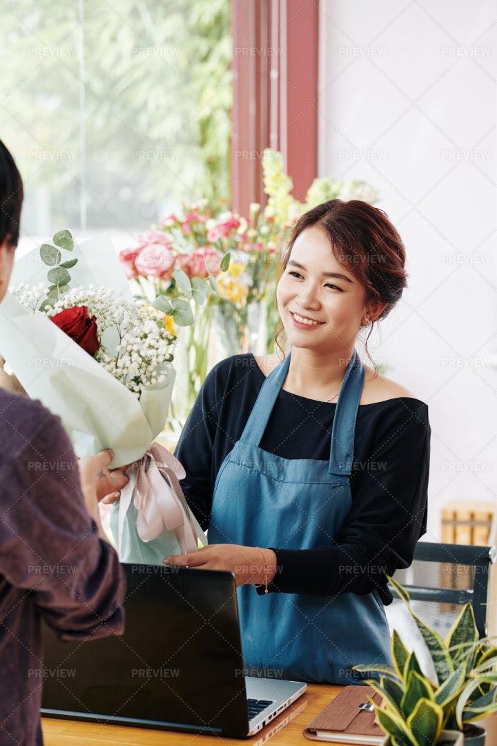 Florist Selling Bouquet: Stock Photos