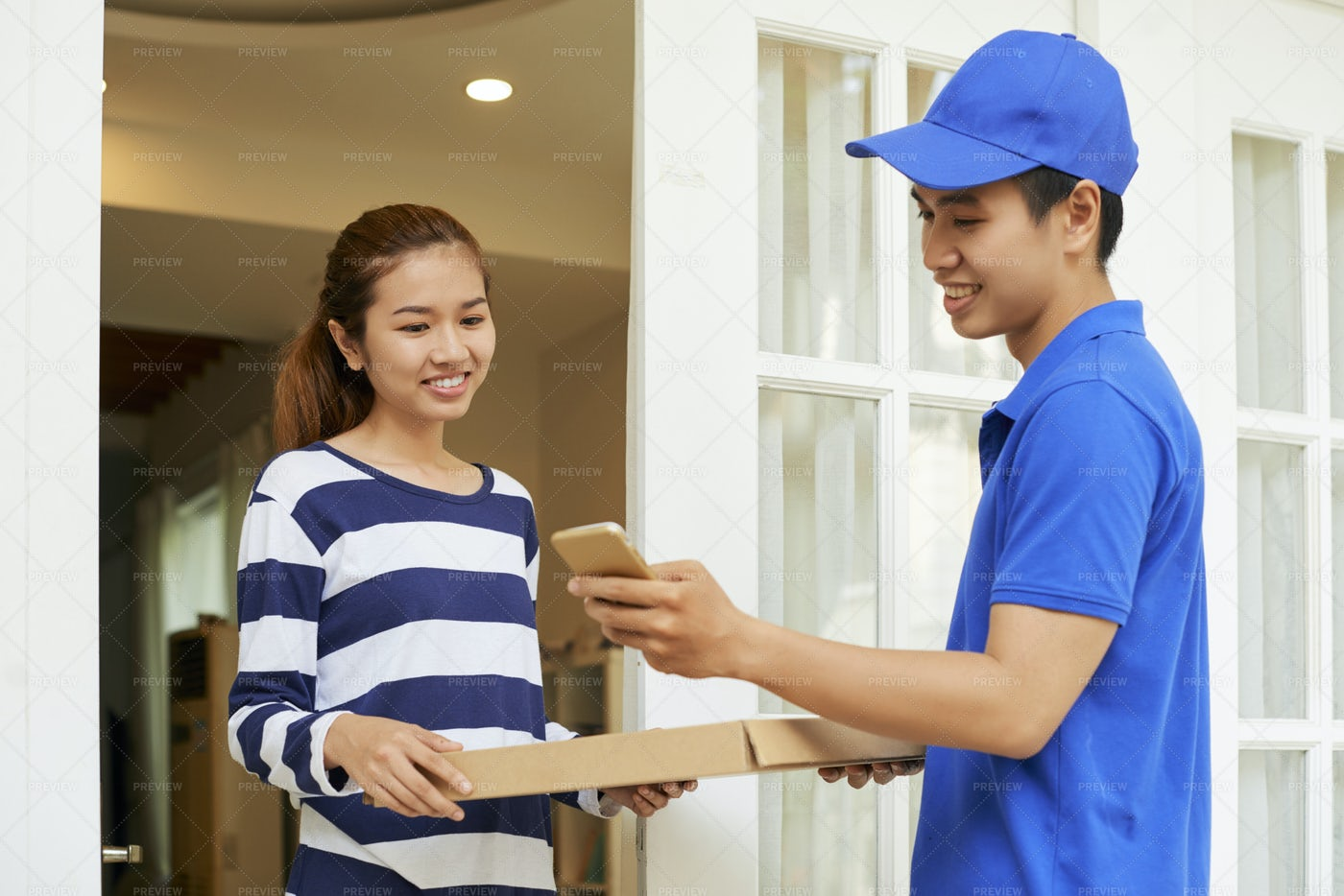 Delivery Man Accepting Payment Via: Stock Photos