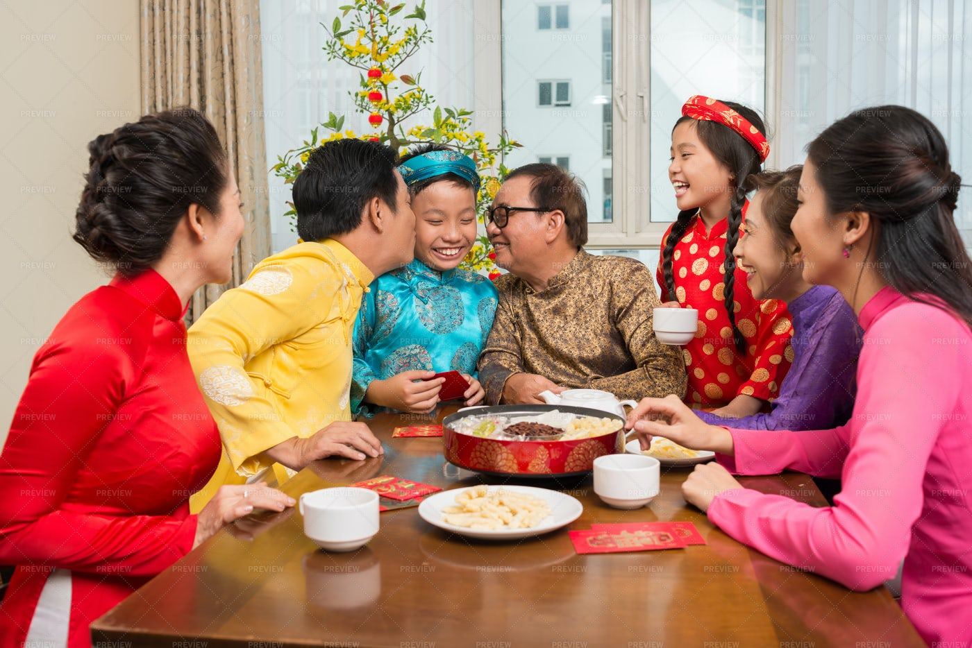 Vietnamese Family Celebrating Tet: Stock Photos