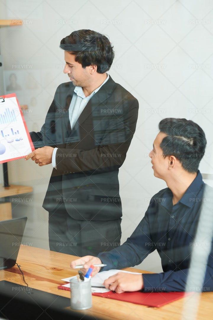 Businessman With Report At Meeting: Stock Photos
