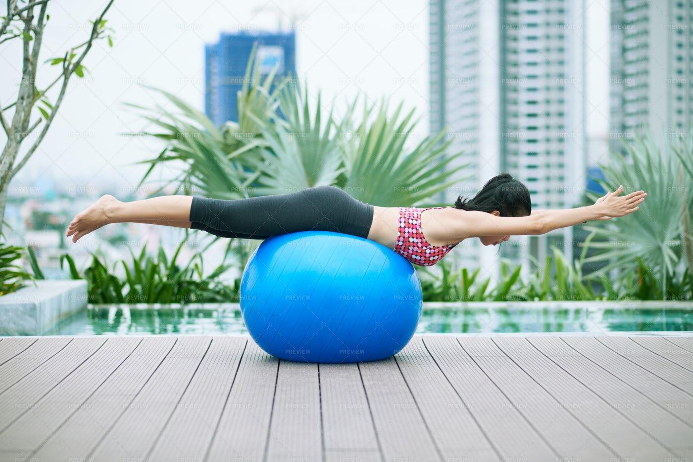 Girl Exercising On Fitness Ball: Stock Photos