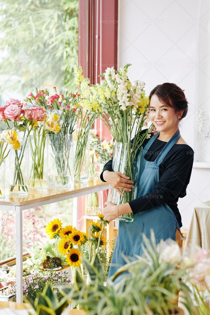 Pretty Florist With Vase Of Flowers: Stock Photos