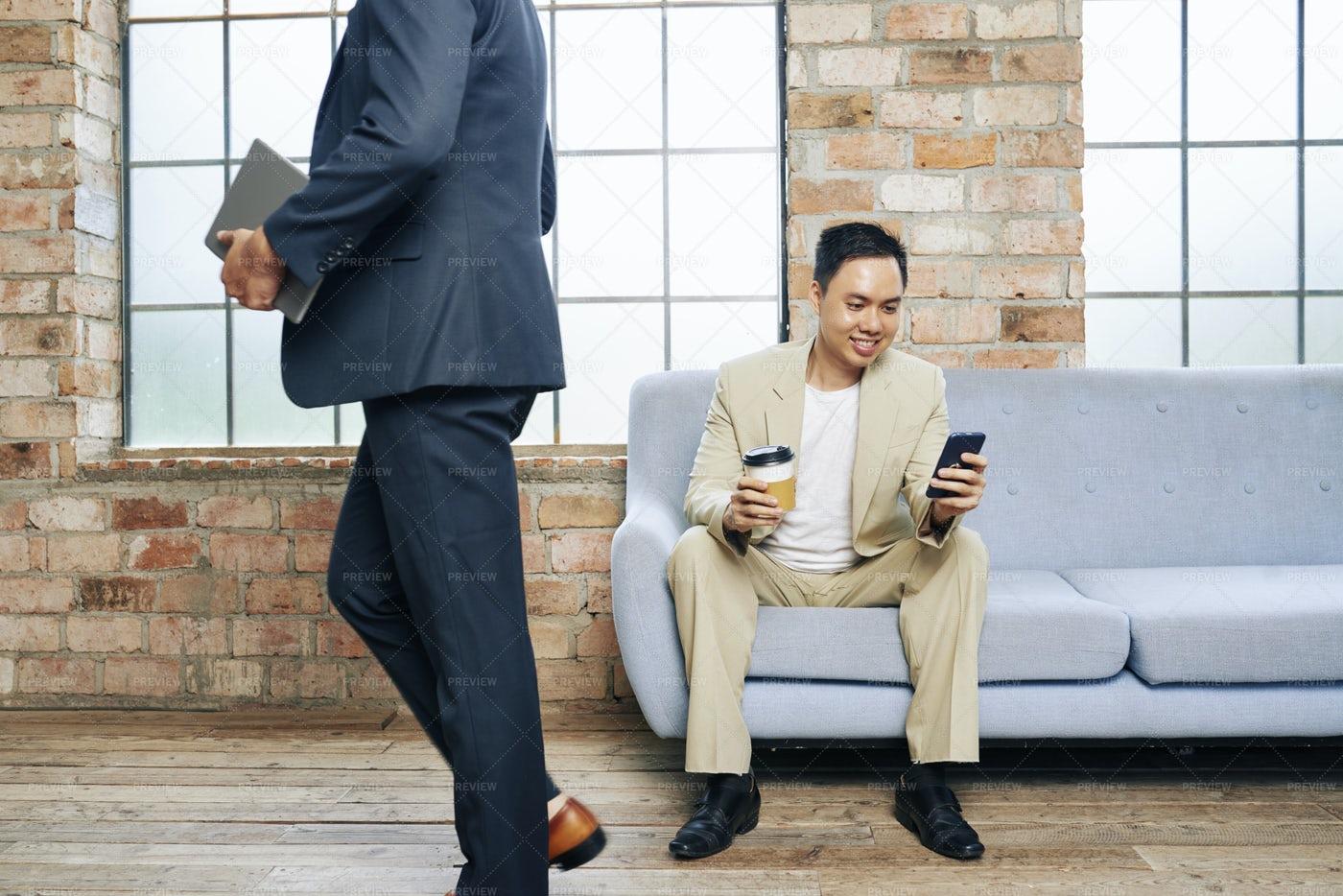 Smiling Texting Businessman: Stock Photos
