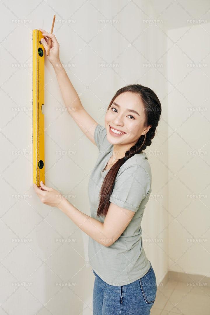Woman Drawing Mark On Wall: Stock Photos