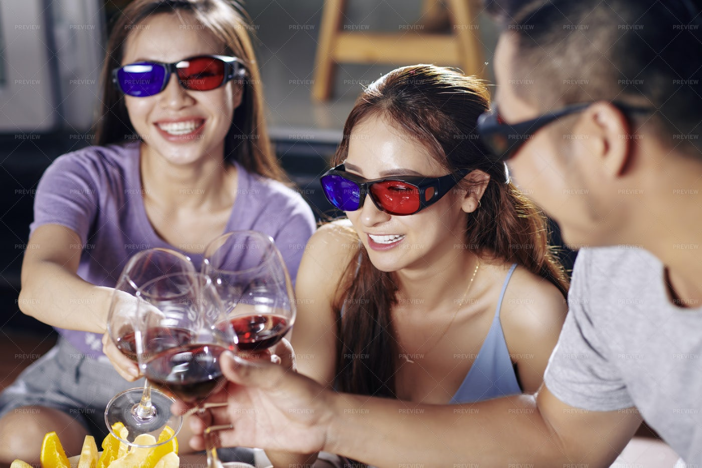 Friends Watching Movie And Drinking: Stock Photos