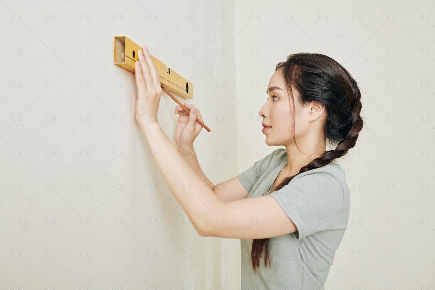 Woman Renovating Room: Stock Photos