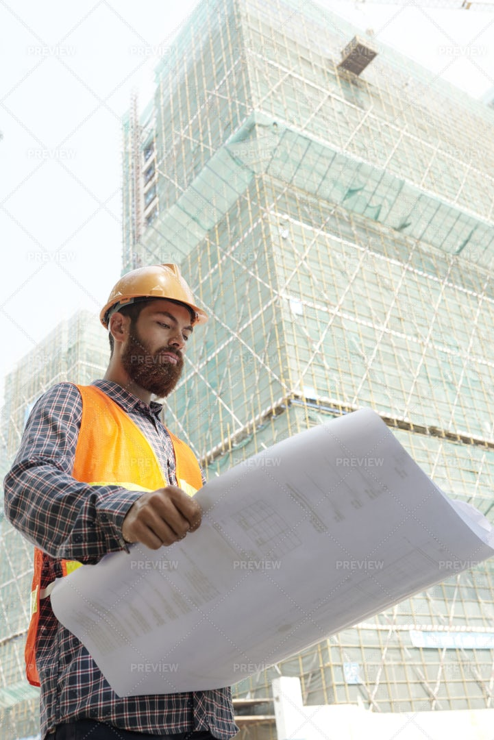 Serious Foreman With Blueprint: Stock Photos