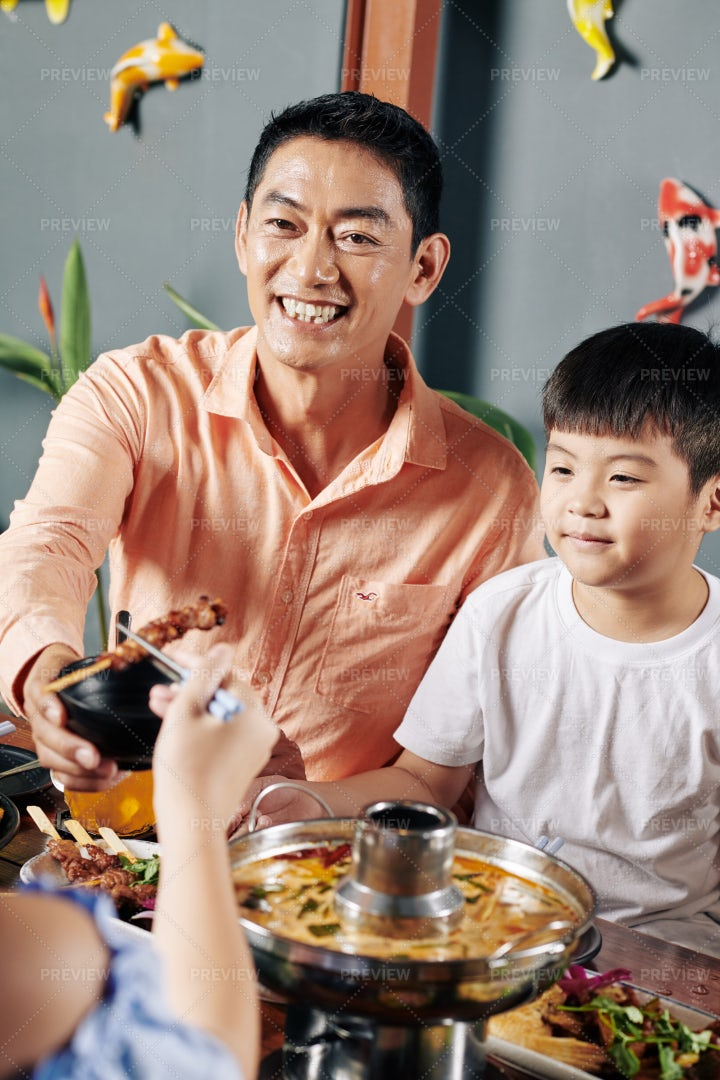Father Having Dinner With Kids: Stock Photos