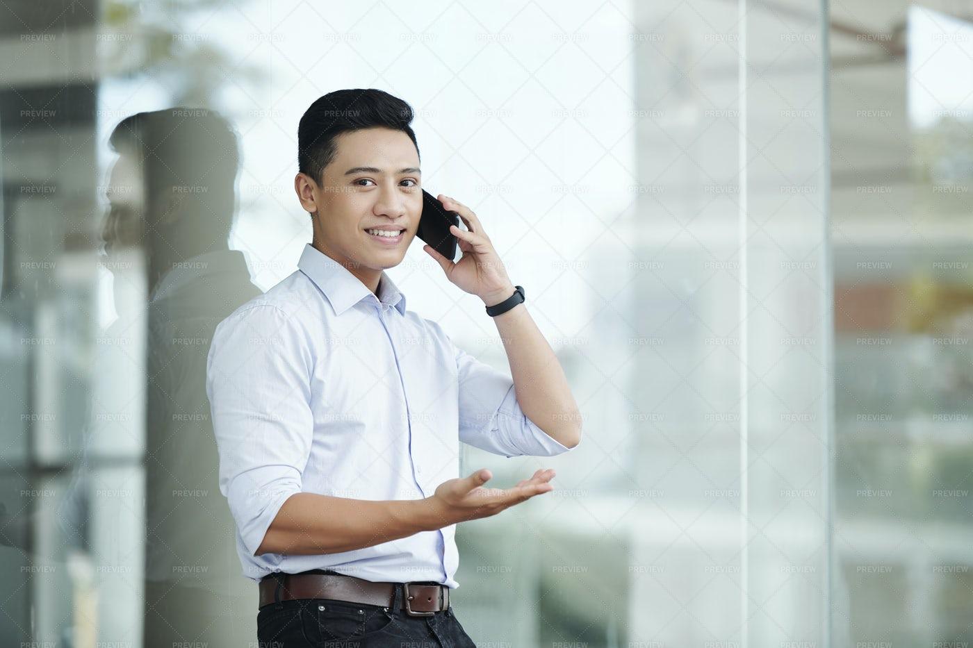 Confident Businessman Calling On Phone: Stock Photos