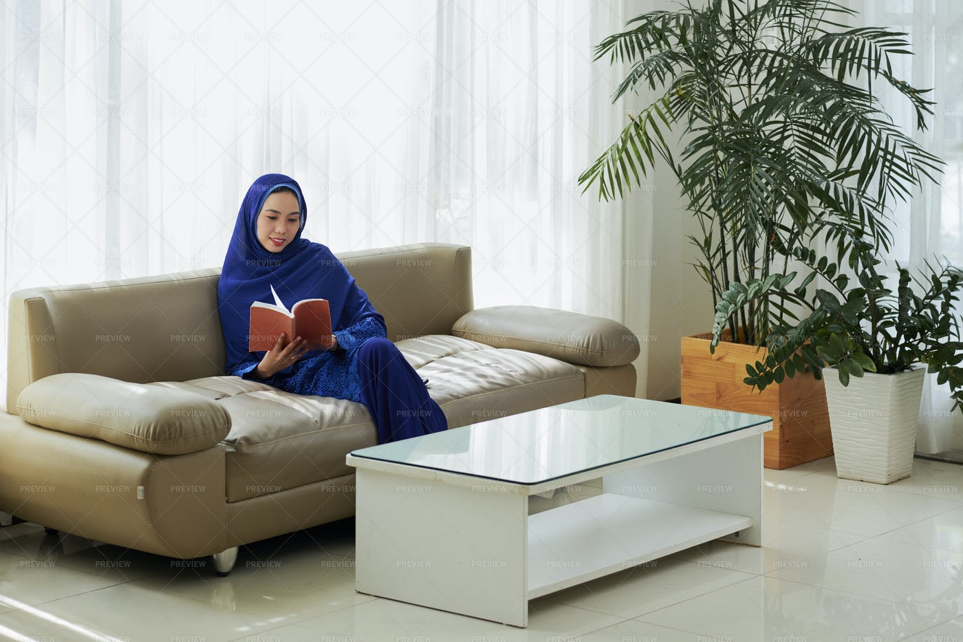 Muslim Woman Resting At Home: Stock Photos